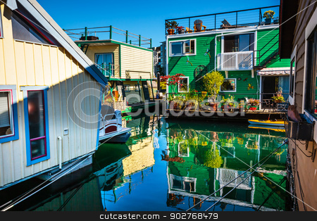Floating Home Village Green Brown Houseboats Fisherman's Wharf R stock photo, Floating Home Village Green Brown Houseboats Fisherman's Wharf Reflection Inner Harbor, Victoria Vancouver British Columbia Canada Pacific Northwest.  Close to the center of Victoria, this area has floating homes, boats, piers, and restuarants.  by William Perry