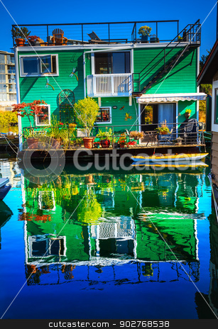 Green Houseboat Floating Home Village Fisherman's Wharf Reflecti stock photo, Green Houseboat Floating Home VFisherman's Wharf Reflection Inner Harbor, Victoria Vancouver British Columbia Canada Pacific Northwest.  Close to the center of Victoria, this area has floating homes, boats, piers, and restuarants.  by William Perry