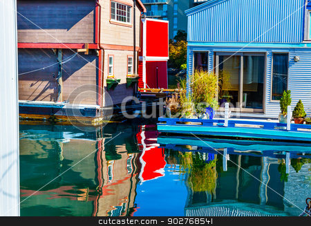 Floating Home Village Red Blue Brown Houseboats Fisherman's Whar stock photo, Floating Home Village Red Blue Brown Houseboats Fisherman's Wharf Reflection Inner Harbor, Victoria Vancouver British Columbia Canada Pacific Northwest.  Close to the center of Victoria, this area has floating homes, boats, piers, and restuarants.  by William Perry