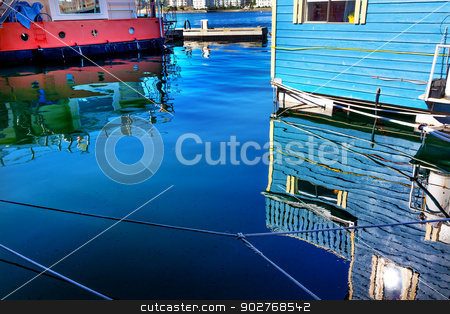 Reflections Blue Floating Home Village Houseboats Fisherman's Wh stock photo, Reflections Blue Floating Home Village Houseboats Fisherman's Wharf Reflection Inner Harbor, Victoria Vancouver British Columbia Canada Pacific Northwest.  Close to the center of Victoria, this area has floating homes, boats, piers, and restuarants.  by William Perry