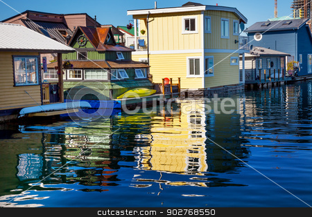 Floating Home Village Yellow Brown Houseboats Fisherman's Wharf  stock photo, Floating Home Village Yellow Brown Houseboats Fisherman's Wharf Reflection Inner Harbor, Victoria Vancouver British Columbia Canada Pacific Northwest.  Close to the center of Victoria, this area has floating homes, boats, piers, and restuarants.  by William Perry