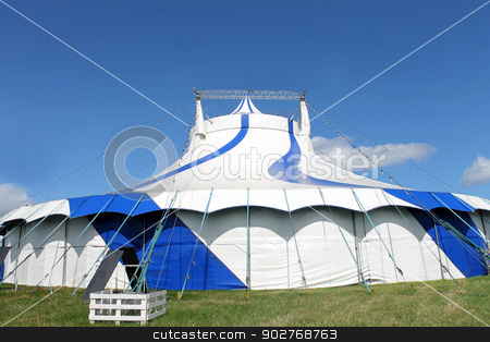 Blue and white big top tent stock photo, Blue and white big top circus tent in field. by Martin Crowdy