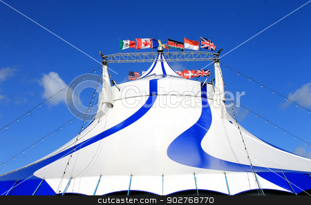 Circus tent with world flags stock photo, Exterior of circus tent with world flags, blue sky background. by Martin Crowdy