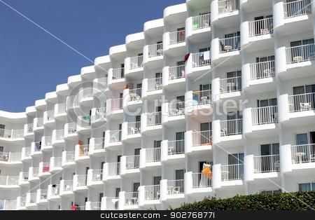 Generic white tourist hotel stock photo, Generic white tourist hotel with towels hanging from balconies. by Martin Crowdy