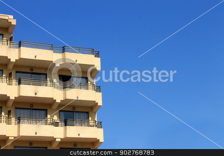 Old hotel building exterior stock photo, Old hotel building with blue sky background. by Martin Crowdy