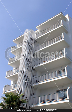 White tourist hotel stock photo, Low angle view of white tourist hotel with blue sky background. by Martin Crowdy