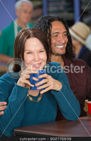 Smiling Interracial Couple stock photo, Smiling interracial couple sitting in coffee house by Scott Griessel