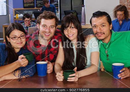 Diverse Group of Friends stock photo, Happy diverse group of friends with coffee in cafe by Scott Griessel