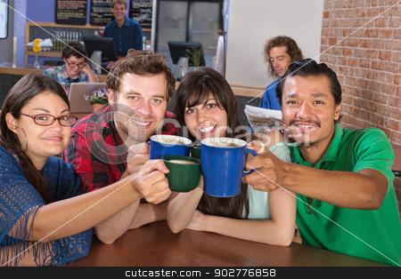 Joyful Group Holding Mugs stock photo, Four joyful people holding up coffee mugs by Scott Griessel
