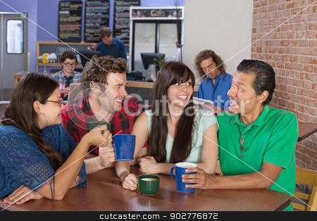 Cheerful Friends Socializing stock photo, Cheerful group of people socializing in a coffee house by Scott Griessel