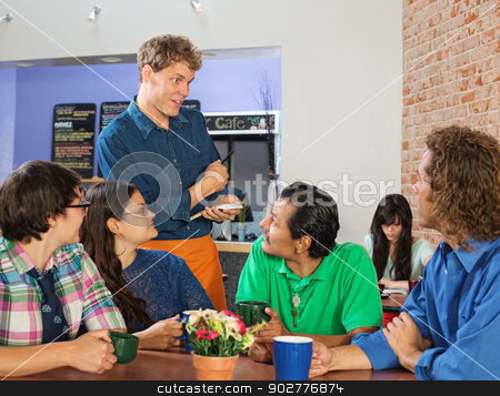 Friendly Server with Group stock photo, Friendly server taking orders from people in cafe by Scott Griessel