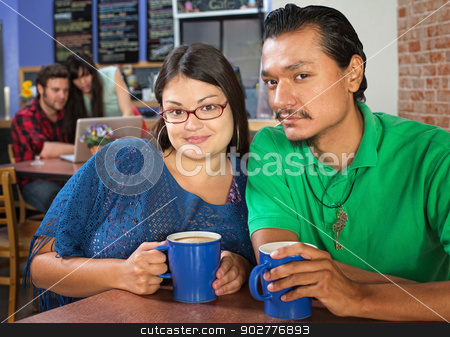 Sweethearts in a Cafe stock photo, Young couple sitting in a coffee house by Scott Griessel