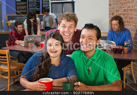 Cute Friends Laughing stock photo, Two men and woman laughing in a cafe by Scott Griessel