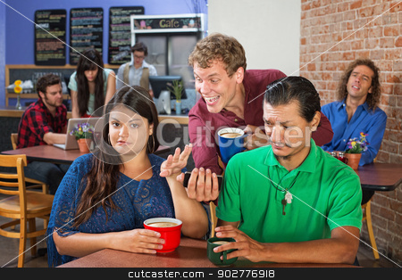 Annoyed Couple and Man with Phone stock photo, Annoyed mixed couple with man showing his phone by Scott Griessel