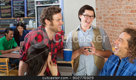 Laughing Group in Cafe stock photo, Happy group of young people laughing in cafe by Scott Griessel