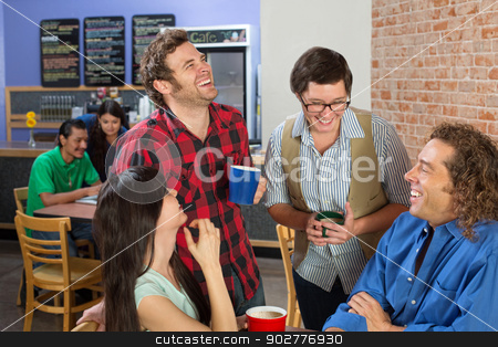 Four People Joking stock photo, Four friends joking in a coffee house by Scott Griessel