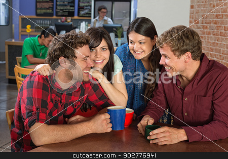 Close Friends in Cafe stock photo, Close friends laughing in a coffee house by Scott Griessel