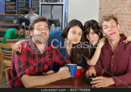 People Making Faces stock photo, Silly group of people making faces in a bistro by Scott Griessel
