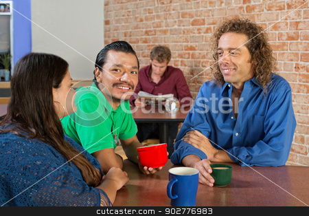 Cheerful Group in Cafe stock photo, Smiling mixed group of friends drinking coffee in a cafe by Scott Griessel