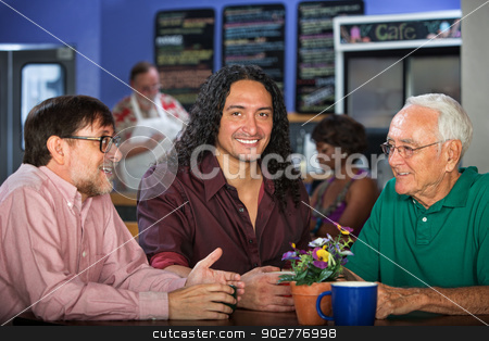 Multi Generational Group in Cafe stock photo, Multi generational group of adults in restaurant by Scott Griessel