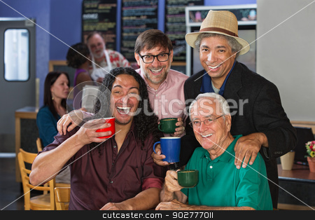 Diverse Men Celebrating stock photo, Diverse group of men celebrating in coffee house by Scott Griessel