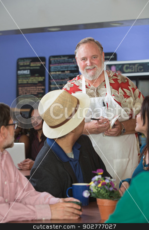 Server Taking Orders stock photo, Cheerful restaurant server with group of customers by Scott Griessel