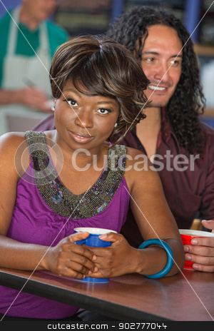 Cute Mixed Couple stock photo, Cute African and Mexican couple in cafe by Scott Griessel