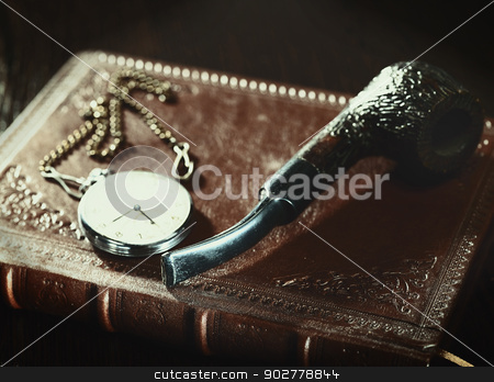 Abstract retro still life with old leather covered book and watc stock photo, Abstract retro still life with old leather covered book and watch by tolokonov