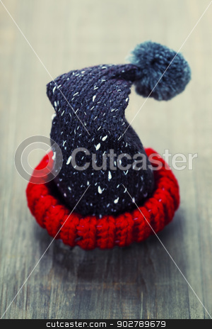 Santa's hat stock photo, Santa's hat  on a rustic wooden table by klenova