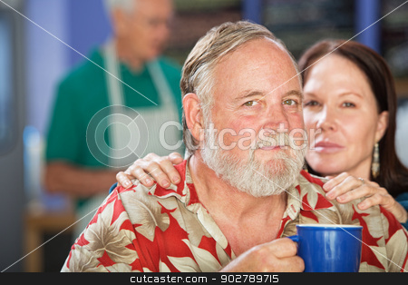 Attractive Couple in Cafe stock photo, Attractive mature couple with coffee in cafe by Scott Griessel