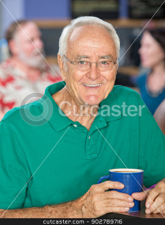 Cheerful Handsome Man stock photo, Handsome senior male smiling with coffee mug by Scott Griessel