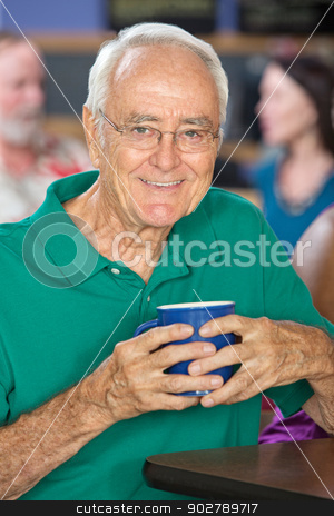 Happy Man with Cup stock photo, Happy single mature male holding coffee mug by Scott Griessel