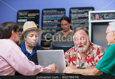 Serious Men Talking stock photo, Four serious mature men in cafe with laptop by Scott Griessel