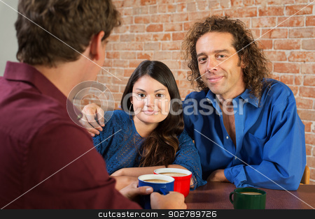 Cute Mixed Couple in Cafe stock photo, Cute mixed white and Hispanic couple in cafe by Scott Griessel