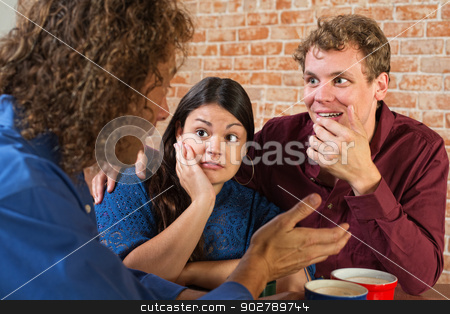 Three Young Adult Friends stock photo, Fascinated friends listening to man in cafe by Scott Griessel