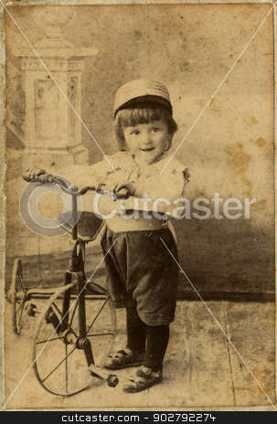 Little boy on a bicycle stock photo, A little boy on a bicycle. Old photo by dvarg