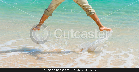 Have a fun near blue sea stock photo, Male legs under clean blue sea water jumping up and splashing water by Iryna Rasko
