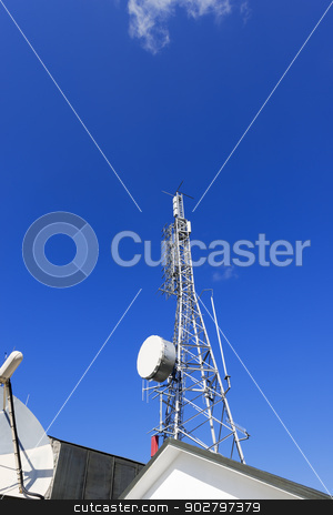 Telecommunication Tower on Blue Sky stock photo, Communication tower and satellite dish on the roof with a beautiful blue sky by catalby