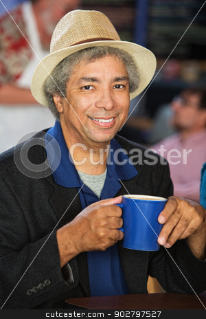 Happy Man with Coffee stock photo, Smiling African man with hat and coffee cup by Scott Griessel