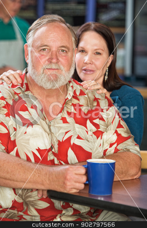Cute Couple in Cafe stock photo, Cute middle aged Caucasian couple in cafe by Scott Griessel