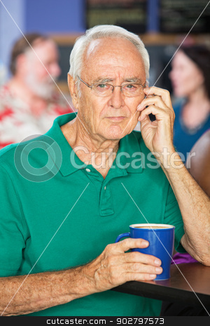Serious Man with Coffee stock photo, Thoughtful single senior male with coffee mug by Scott Griessel