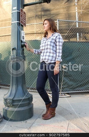 Woman waiting stock photo, Woman waiting at a cross walk. by Henrik Lehnerer