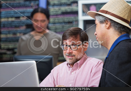 Two Mature Men Talking stock photo, Two mature men talking in a coffee house by Scott Griessel