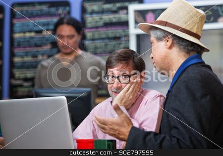 Man with Hand on Cheek stock photo, Mature man with hand on cheek in a coffee house by Scott Griessel