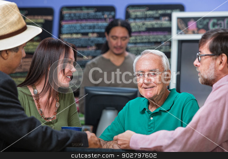 Cheerful Older Man in Cafe stock photo, Cheerful older male with group of friends in cafe by Scott Griessel