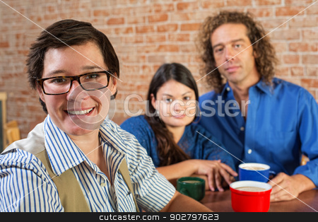 Happy Woman in Restaurant stock photo, Cheerful woman with eyeglasses and friends in cafe by Scott Griessel
