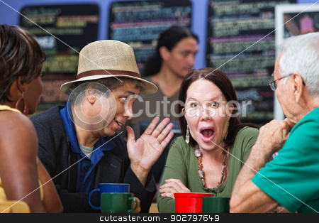 Embarrassed Group in Cafe stock photo, Diverse group of adults ashamed and listening to man by Scott Griessel