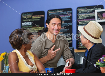 Handsome Man Taking Orders stock photo, Handsome cafe owner with diverse customers taking orders by Scott Griessel