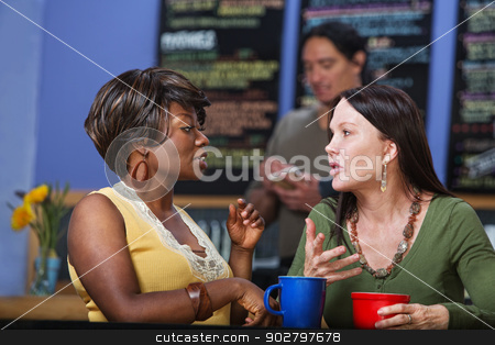 Calm Women in Conversation stock photo, Pair of calm women in conversation at coffee house by Scott Griessel