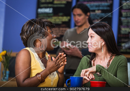 Enthusiastic Woman Talking stock photo, Enthusiastic Hispanic woman talking with friend in cafe by Scott Griessel
